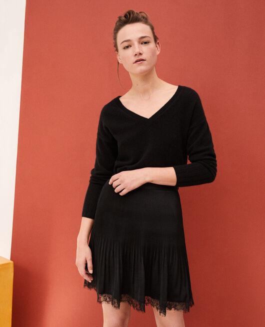 Falda plisada con detalle de encaje Negro